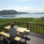 Relax on the decking of our Rowan Chalet whilst enjoying the view over the Summer Isles