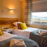 Our twin or superking bedroom with sea view at Port Beag Chalets, Altandhu