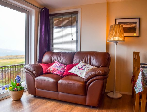 Our lounge with patio doors leading to outside decking at our Rowan Cottage, Port Beag Holidays